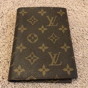 Luis Vuitton passport holder/wallet.